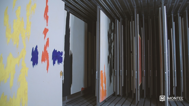 Hang student paintings on double-sided mobile art racks.